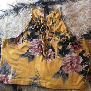 Yellow crop top with floral designs